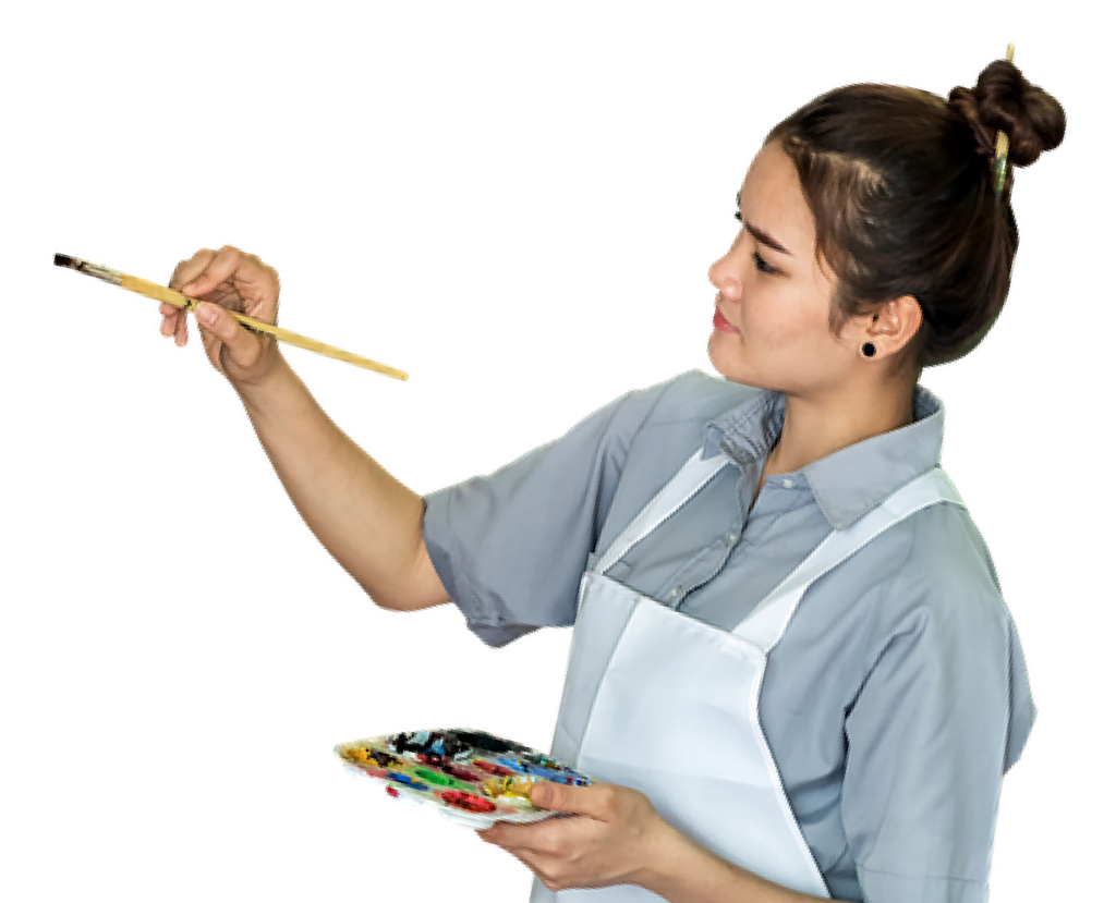 girl holding a paintbrush looking left