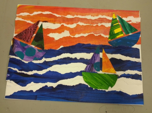 student work on a collage of ships on a wavy sea.