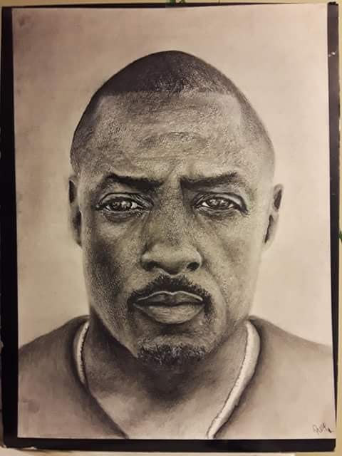 realistic pencil drawing of actor Idris Elba.
